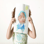 2.Child Holding Up Drawing_300x300
